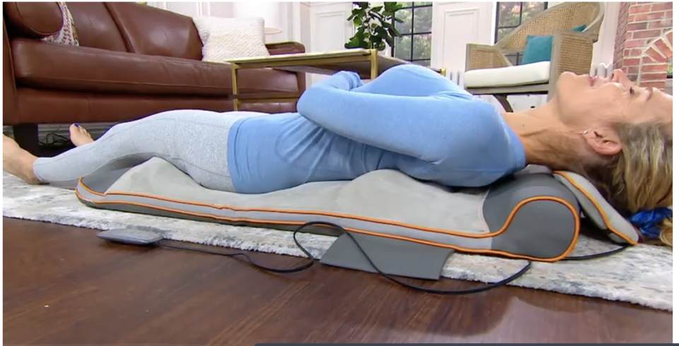 The HoMedics Air Compression Back Stretching Mat in action on QVC. (Photo: QVC)