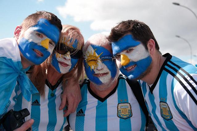 Argentina fans cheer prior to the 2014 FIFA World Cup final football match between Germany and Argentina at the Maracana Stadium in Rio de Janeiro, Brazil on July 13, 2014. AFP PHOTO / DAMIEN MEYER (AFP Photo/DAMIEN MEYER)