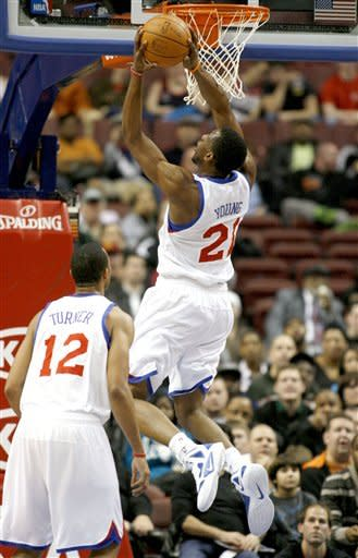 Philadelphia 76ers' Thaddeus Young (21) scores against the Washington Wizards in the first half of an NBA basketball game Monday, Jan, 23, 2012, in Philadelphia. (AP Photo/H. Rumph Jr )