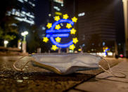 A face mask was left behind near the Euro sculpture in Frankfurt, Germany, early Monday, Oct. 19, 2020. (AP Photo/Michael Probst)