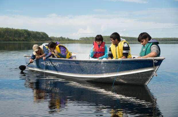 The Deh Cho K'ehondi program, part of the Indigenous Guardians pilot, brings young people onto the land to learn about their culture and the environment. Programs like this have been found to have social, economic and environmental returns. (Pat Kane - image credit)