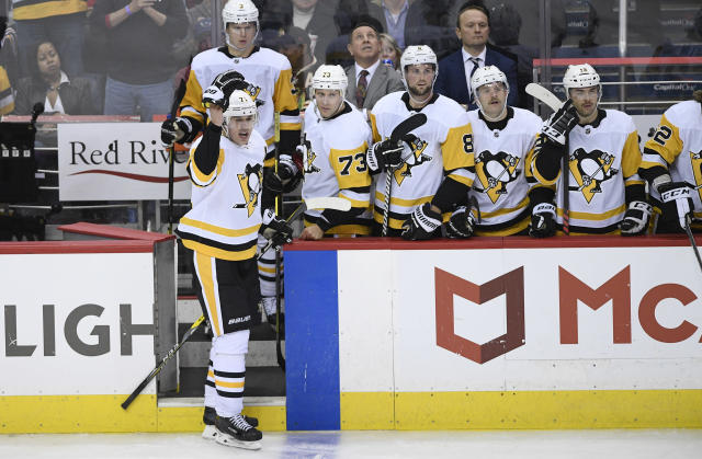 Pittsburgh Penguins center Evgeni Malkin, left, of Russia, gestures as he leaves the ice after he was given a match penalty during the third period of an NHL hockey game against the Washington Capitals, Wednesday, Nov. 7, 2018, in Washington. The Capitals won 2-1. (AP Photo/Nick Wass)