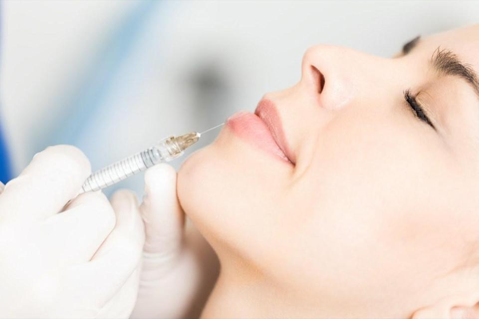 woman getting injectable filler from doctor