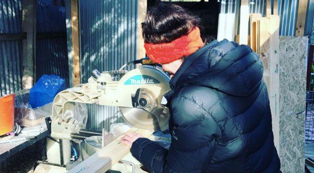 Charlotte getting her hands dirty during the build. Source: Charlotte Sapwell