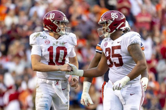 Alabama quarterback Mac Jones (10) and tight end Kendall Randolph (85) celebrate a touchdown during the first half of an NCAA college football game against Auburn, Saturday, Nov. 30, 2019, in Auburn, Ala. (AP Photo/Vasha Hunt)