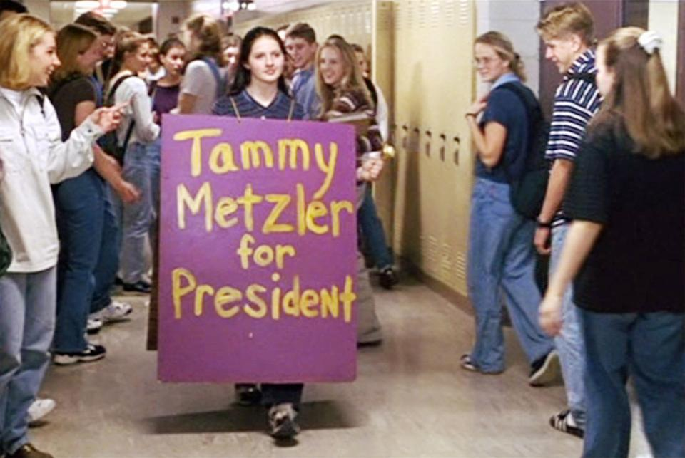 """LOS ANGELES - APRIL 23: The movie """"Election"""", directed by Alexander Payne. Seen here in center, Jessica Campbell (as Tammy Metzler). She wears a sandwich board featuring the slogan, 'Tammy Metzler for President'. Initial theatrical release, Friday, April 23, 1999. Image is a screen grab. (Photo by CBS via Getty Images)"""