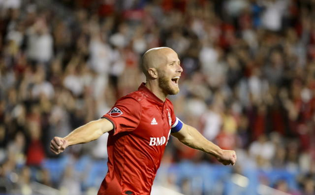 Toronto FC midfielder Michael Bradley celebrates after teammate Justin Morrow scored against the Montreal Impact during second-half MLS soccer match action in Toronto, Saturday, Aug. 24, 2019. (Andrew Lahodynskyj/The Canadian Press via AP)