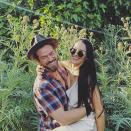 """Although a source confirmed to PEOPLE that <i>Dancing with the Stars</i> costars<a href=""""https://people.com/tv/nikki-bella-dwts-partner-artem-chigvinstev-are-dating/"""" rel=""""nofollow noopener"""" target=""""_blank"""" data-ylk=""""slk:Bella and Chigvintsev began casually dating back in January"""" class=""""link rapid-noclick-resp""""> Bella and Chigvintsev began casually dating back in January</a>, the two have since ramped up their summer PDA in public and on social media. The pair were spotted holding hands and locking lips while out in L.A. in early May after grabbing lunch together. The romantic rendezvous came just days after the two accompanied Bella's twin sister Brie and her husband Daniel Bryan on a<a href=""""https://people.com/tv/nikki-bella-artem-chigvintsev-brie-bella-disneyland/"""" rel=""""nofollow noopener"""" target=""""_blank"""" data-ylk=""""slk:trip to Disneyland"""" class=""""link rapid-noclick-resp""""> trip to Disneyland</a> to celebrate Brie's daughter Birdie's second birthday. Although Bella has called Chigvintsev an """"<a href=""""https://people.com/tv/nikki-bella-calls-artem-chigvinstev-amazing-lover/"""" rel=""""nofollow noopener"""" target=""""_blank"""" data-ylk=""""slk:amazing lover"""" class=""""link rapid-noclick-resp"""">amazing lover</a>,"""" she's been insistent on ditching the """"boyfriend"""" label — until now. On Wednesday's episode of <a href=""""https://player.fm/series/the-bellas-podcast"""" rel=""""nofollow noopener"""" target=""""_blank"""" data-ylk=""""slk:The Bellas Podcast"""" class=""""link rapid-noclick-resp""""><i>The Bellas Podcast</i></a>, the retired wrestler revealed that she and Chigvintsev are <a href=""""https://people.com/tv/nikki-bella-artem-chigvintsev-official-boyfriend-girlfriend/"""" rel=""""nofollow noopener"""" target=""""_blank"""" data-ylk=""""slk:finally official"""" class=""""link rapid-noclick-resp"""">finally official</a>. To help announce their new status, the couple has choreographed and performed a dance to tell the story of their romance. Fans can watch the entire video on <a href=""""https://www.youtube.com/watch?v=EsW14eSIFLQ"""" rel=""""nofollow n"""