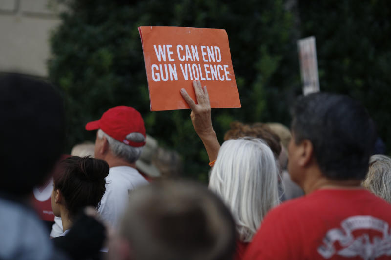 LOUISVILLE, KY - AUGUST 06: An activist holds a sign while demonstrating outside the office of Senate Majority Leader Mitch McConnell (R-KY) on August 6, 2019 in Louisville, Kentucky. Protestors from Kentucky March For Our Lives held a candlelight vigil and called on McConnell to pass legislation expanding background checks for firearms purchases in the wake of shootings in El Paso, Texas and Dayton, Ohio. (Photo by Luke Sharrett/Getty Images)