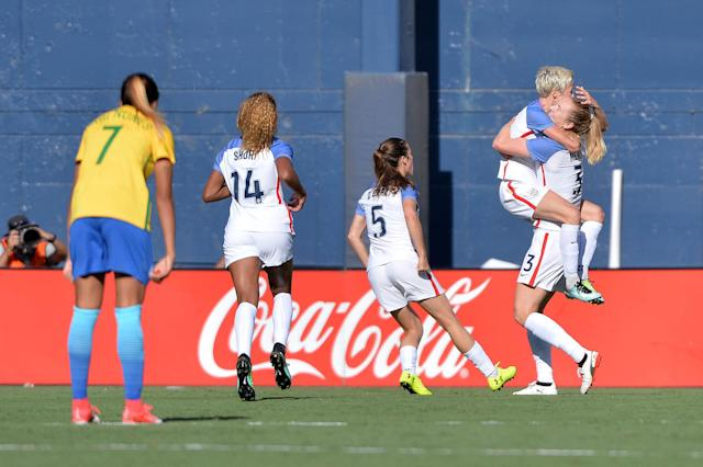 Jul 30, 2017; San Diego, CA, USA; United States midfielder Megan Rapinoe (15) jumps into the arms of Samantha Mewis (3) after Mewis scored a goal during the first half against Brazil at Qualcomm Stadium. Mandatory Credit: Orlando Ramirez-USA TODAY Sports TPX IMAGES OF THE DAY