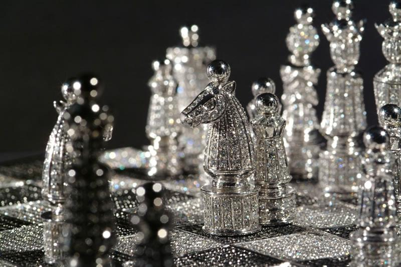 <b>Charles Hollander's glitzy chess</b><br> Made of 14-carat white gold and encrusted with over 9,000 diamonds, the Charles Hollander chess set is truly fit for a king -- or anyone else with half a million dollars and nothing better to spend it on. Before you dismiss that as an unlikely eventuality, consider this: master jeweler Hollander has made seven such sets, and sold all but one. (Image credit: Charles Hollander)