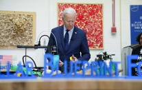 President Joe Biden tours the Cuyahoga Community College Manufacturing Technology Center, Thursday, May 27, 2021, in Cleveland. (AP Photo/Evan Vucci)
