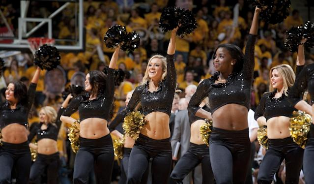 The Missouri Golden Girls perform during a timeout in the first half of an NCAA college basketball game against Texas A&M Wednesday, March 5, 2014, in Columbia, Mo. (AP Photo/L.G. Patterson)