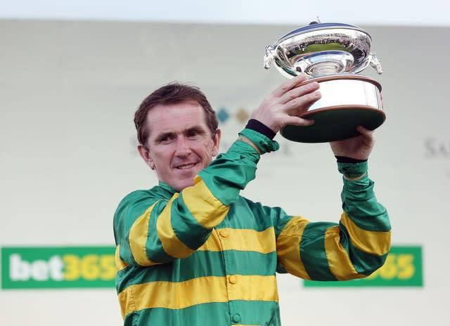 The sight of McCoy lifting the champion jockey trophy at the end of the season was a regular one (David Davies/PA)