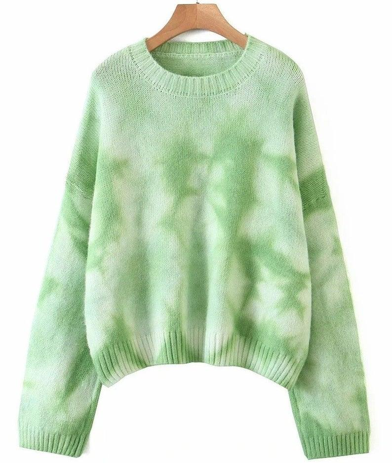 """<br><br><strong>UniformedMask</strong> Tie-Dye Printed Loose Long Sleeve Knitwear Sweater, $, available at <a href=""""https://go.skimresources.com/?id=30283X879131&url=https%3A%2F%2Fwww.etsy.com%2Flisting%2F843754992%2Ftie-dye-printed-loose-long-sleeve%3Fga_order%3Dmost_relevant%26ga_search_type%3Dall%26ga_view_type%3Dgallery%26ga_search_query%3Dtie%2Bdye%2Bsweater%26ref%3Dsr_gallery-2-11"""" rel=""""nofollow noopener"""" target=""""_blank"""" data-ylk=""""slk:Etsy"""" class=""""link rapid-noclick-resp"""">Etsy</a>"""