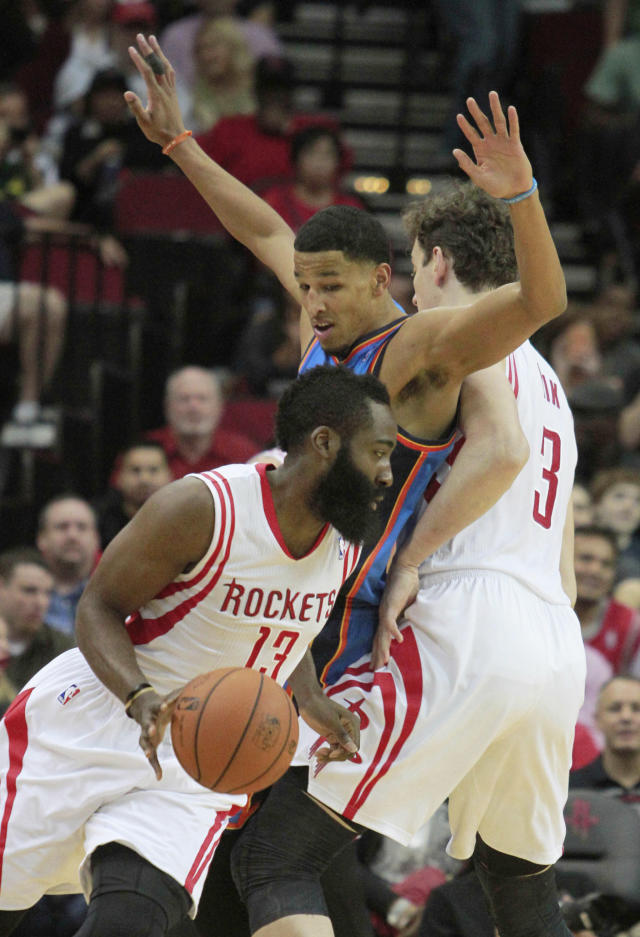 Houston Rockets center Omer Asik, 3, sets a pick on Oklahoma City Thunder guard Andre Roberson, center, for teammate James Harden during an NBA basketball game in Houston Friday, April 4, 2014. (AP Photo/Richard Carson)