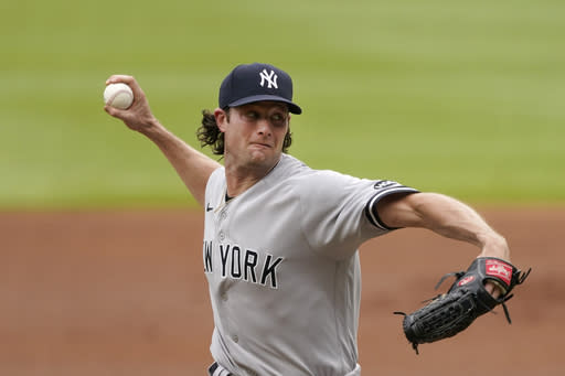 New York Yankees starting pitcher Gerrit Cole works in the second inning of game one of a baseball doubleheader Wednesday, Aug. 26, 2020, in Atlanta. (AP Photo/John Bazemore)