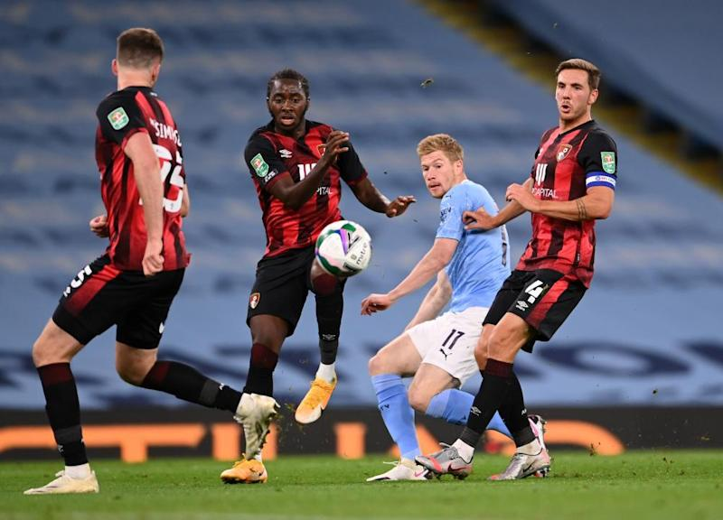 Kevin De Bruyne of Manchester City gets a shot away despite the attention of the Bournemouth defence in their Carabao Cup meeting.