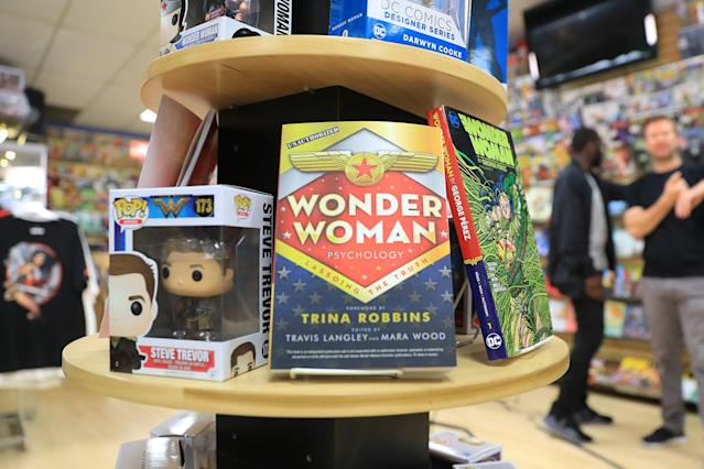"<p>Books and toys from characters of the ""Wonder Woman"" series are on display at Midtown Comics in New York City. (Gordon Donovan/Yahoo News) </p>"