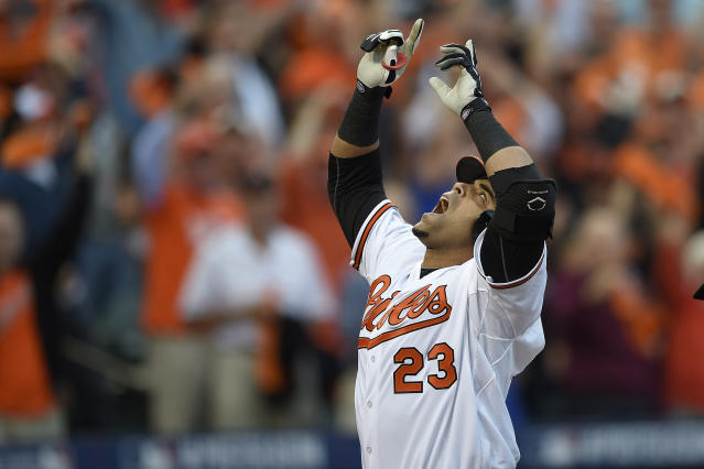 Baltimore Orioles designated hitter Nelson Cruz gestures after his two-run home run in the first inning against the Detroit Tigers during Game 1 of baseball's AL Division Series, Thursday, Oct. 2, 2014, in Baltimore. (AP Photo/Nick Wass)