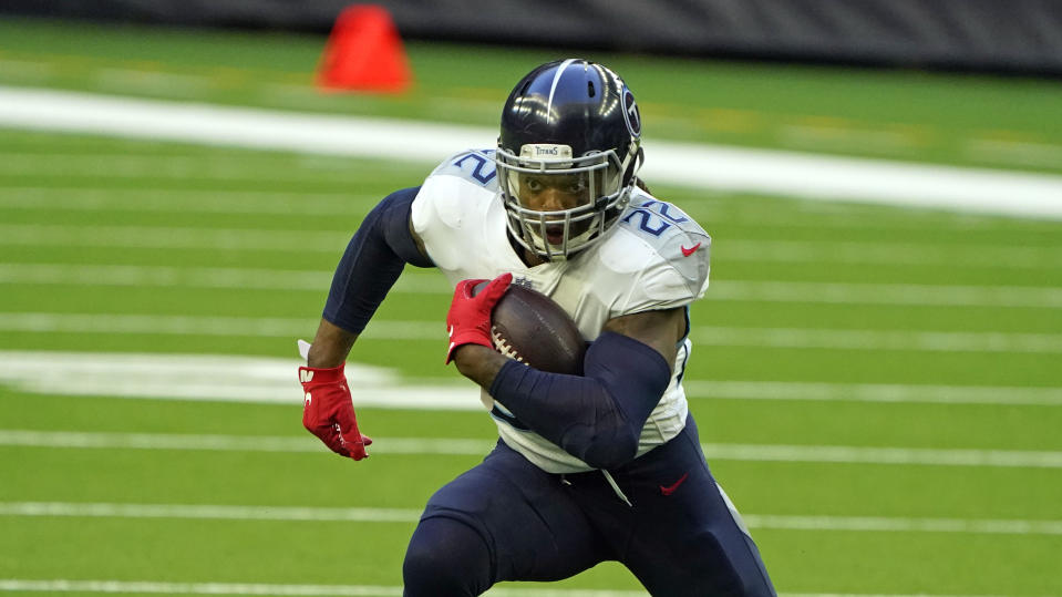 Tennessee Titans running back Derrick Henry (22) rushes for a gain against the Houston Texans during the first half of an NFL football game Sunday, Jan. 3, 2021, in Houston. (AP Photo/Eric Christian Smith)