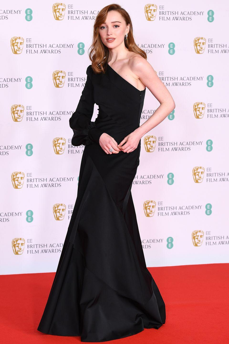 <p>Another lady who made a striking entrance in Louis Vuitton was Bridgerton's Phoebe Dyvenor, who chose a classic black, one-shouldered evening gown for the event.</p>