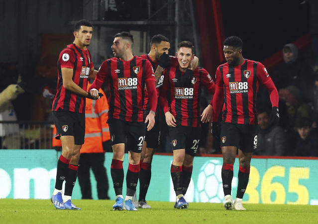 Bournemouth's Harry Wilson, second right, celebrates scoring his side's first goal of the game against Brighton and Hove Albion during their English Premier League soccer match at the Vitality Stadium in Bournemouth, England, Tuesday Jan. 21, 2020. (Mark Kerton/PA via AP)
