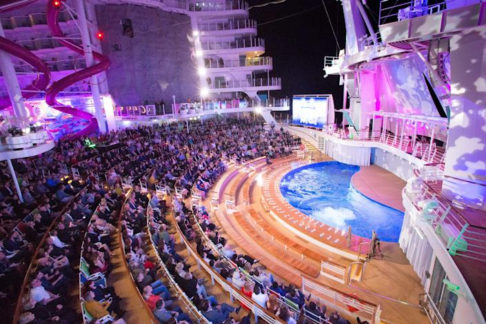 Royal Caribbean's Symphony of the Seas features one of the largest outdoor theaters on a cruise ship. Dubbed the AquaTheater, it's designed with platforms and a deep pool that are used in aerial and water-based performances.