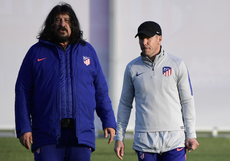 Atletico Madrid's Argentinian coach Diego Simeone (R) and Argentinian assistant coach German Burgos (L) attend a training session at the club's training ground in Madrid on February 19, 2019 ahead of the UEFA Champions League round of 16 first leg football match between Atletico Madrid and Juventus. (Photo by JAVIER SORIANO / AFP) (Photo credit should read JAVIER SORIANO/AFP via Getty Images)