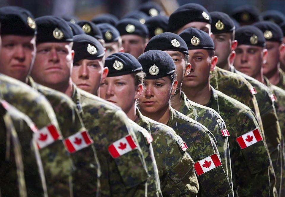 "<span class=""caption"">Members of the Canadian Armed Forces march during the Calgary Stampede parade in Calgary in July 2016.</span> <span class=""attribution""><span class=""source"">THE CANADIAN PRESS/Jeff McIntosh</span></span>"