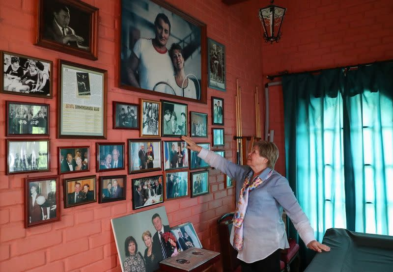 Legendary Soviet gymnast Larisa Latynina, holder of the record for the most Olympic gold medals by a gymnast shows her pictures in home, in village Kalyanino