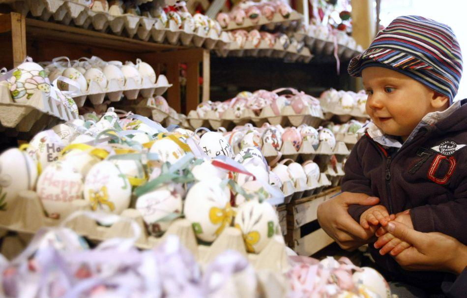 A boy looks at painted Easter eggs at an Easter market in the western Austrian city of Innsbruck