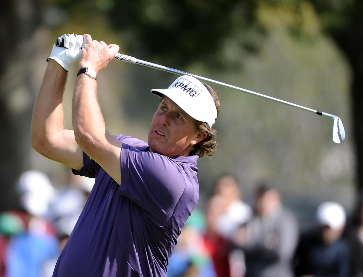 PACIFIC PALISADES, CA - FEBRUARY 18:  Phil Mickelson hits a second shot on the second hole during the third round of the Northern Trust Open at the Riviera Country Club on February 18, 2012 in Pacific Palisades, California.  (Photo by Harry How/Getty Images)