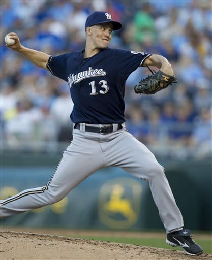 Milwaukee Brewers starter Zack Greinke pitches to Kansas City Royals' Humberto Quintero during the fourth inning of a baseball game at Kauffman Stadium in Kansas City, Mo., Tuesday, June 12, 2012. (AP Photo/Orlin Wagner)