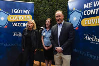 FILE - In this June 29, 2021, file photo first lady Jill Biden and Doug Emhoff participate in a COVID-19 vaccination event at Minute Maid Park, in Houston. (AP Photo/Carolyn Kaster, Pool, File)