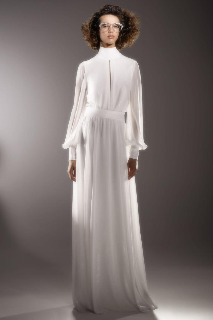 <p>The combination of bishop sleeves, a high neckline, and a keyhole cutout makes this dress the perfect, casual pick for a small ceremony.</p>
