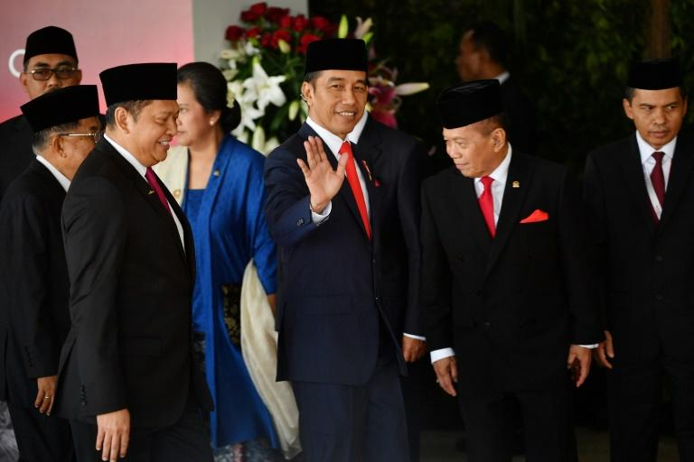 Indonesia's President Joko Widodo (C) said his final term would be aimed at eradicating poverty