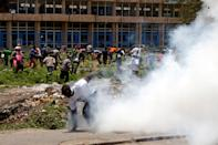 <p>Supporters of Kenyan opposition National Super Alliance (NASA) coalition, run as riot police officers fire tear gas to disperse them along Mombasa Road, Kenya, Nov. 17, 2017. (Photo: Baz Ratner/Reuters) </p>