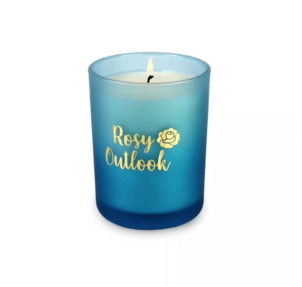 <p>Housed in a chic indigo-blue frosted glass vessel, this <span>Disney Princess X POPSUGAR Belle Candle</span> ($13) has a berry rose scent that will create a relaxing reading ambiance.</p>