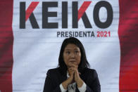 Presidential candidate Keiko Fujimori holds a press conference in Lima, Peru, Saturday, June 12, 2021. Peruvians on Saturday are still waiting to know who will become their president next month as votes from the June 6th runoff election continued to be counted and the tiny difference between the two polarizing populist candidates narrowed. (AP Photo/Martin Mejia)