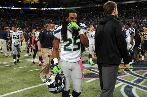 Seattle Seahawks cornerback Richard Sherman (25) walks off the field following an NFL football game against the St. Louis Rams Sunday, Oct. 19, 2014, in St. Louis. The Rams won 28-26. (AP Photo/L.G. Patterson)