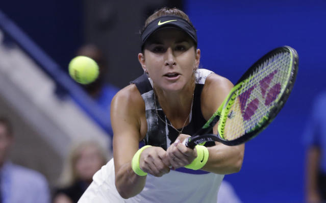 Belinda Bencic, of Switzerland, returns to Naomi Osaka, of Japan, during the fourth round of the US Open tennis championships Monday, Sept. 2, 2019, in New York. (AP Photo/Frank Franklin II)