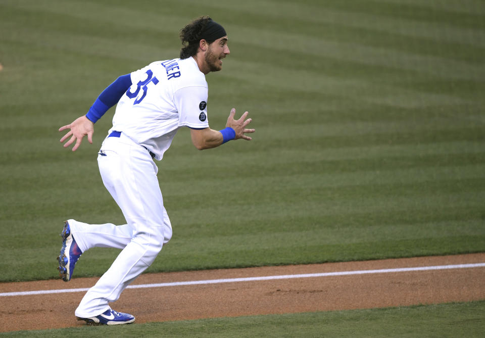 LOS ANGELES, CALIFORNIA - JUNE 02: Cody Bellinger #35 of the Los Angeles Dodgers reacts as he runs home to score on a throwing error from Edmundo Sosa #63 of the St. Louis Cardinals, to take a 4-1 lead, during the first inning at Dodger Stadium on June 02, 2021 in Los Angeles, California. (Photo by Harry How/Getty Images)