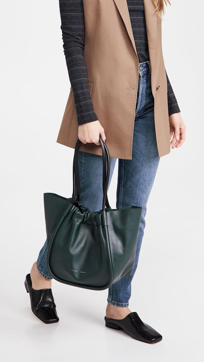 <p>All your friends will want to know where you got this cool <span>Proenza Schouler Large Ruched Tote</span> ($995).</p>