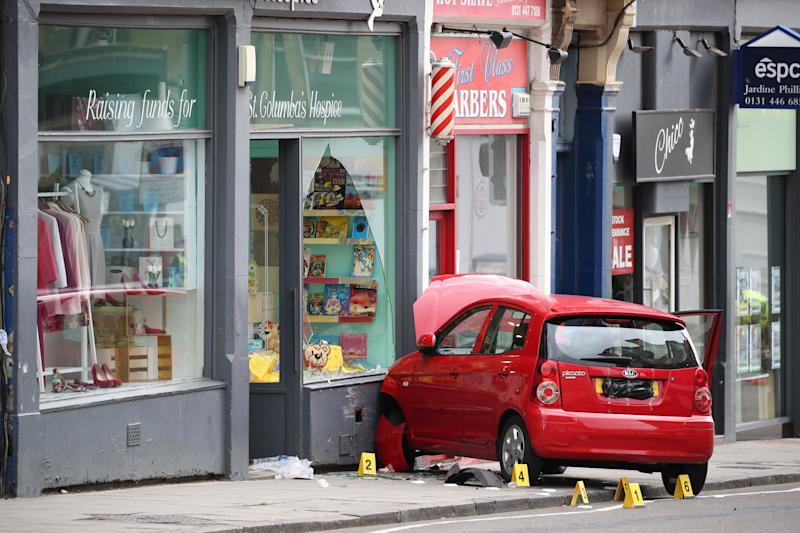 The car which struck Xander Irvine and crashed into a shop in Edinburgh. (PA)