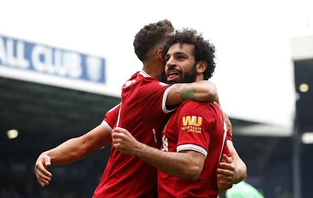 """Soccer Football - Premier League - West Bromwich Albion v Liverpool - The Hawthorns, West Bromwich, Britain - April 21, 2018 Liverpool's Mohamed Salah celebrates scoring their second goal REUTERS/Andrew Yates EDITORIAL USE ONLY. No use with unauthorized audio, video, data, fixture lists, club/league logos or """"live"""" services. Online in-match use limited to 75 images, no video emulation. No use in betting, games or single club/league/player publications. Please contact your account representative for further details."""