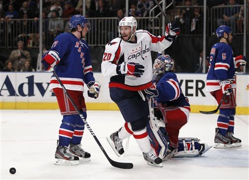 Washington Capitals left wing Troy Brouwer (20) celebrates after Alex Ovechkin (not shown) scored the winning goal in the third period to lift the Capitals to a 3-2 victory over the New York Rangers in Game 2 of the NHL Eastern Conference semifinals at Madison Square Garden in New York, Monday, April 30, 2012. (AP Photo/Kathy Willens)