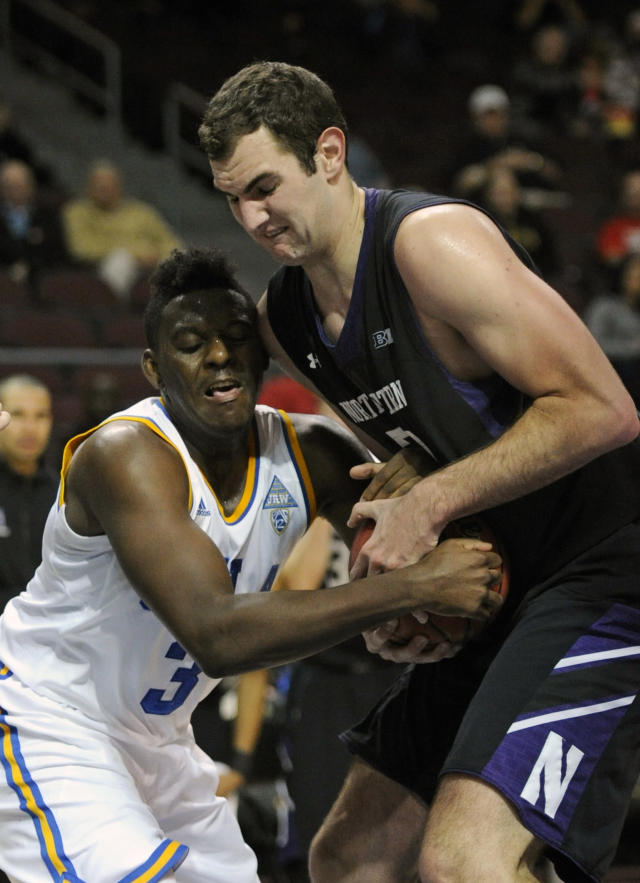 UCLA's Jordan Adams (3) and Northwestern's Alex Olah fight for the ball during the first half of an NCAA college basketball game at the Las Vegas Invitational on Friday, Nov. 29, 2013, in Las Vegas. (AP Photo/David Becker)