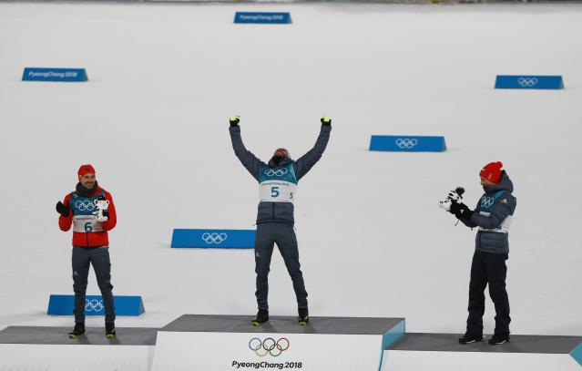 Nordic Combined Events - Pyeongchang 2018 Winter Olympics - Men's Individual 10 km Final - Alpensia Cross-Country Skiing Centre - Pyeongchang, South Korea - February 20, 2018 - Gold medalist, Johannes Rydzek of Germany, silver medalist, Fabian Riessle of Germany and bronze medalist Eric Frenzel of Germany react during the victory ceremony. REUTERS/Dominic Ebenbichler