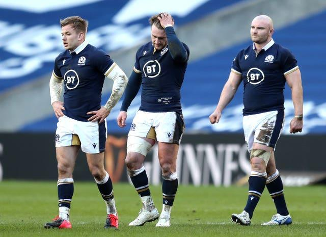 Scotland's Stuart Hogg (centre) looks dejected after his side slumped to their second straight home defeat